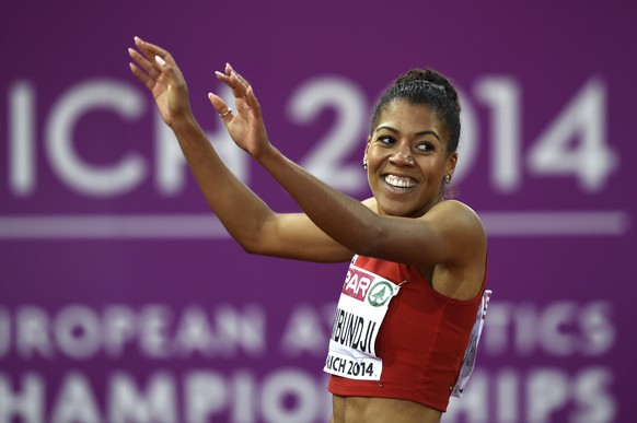Mujinga Kambundji from Switzerland reacts after the women's 200m final, at the fourth day of the European Athletics Championships in the Letzigrund Stadium in Zurich, Switzerland, Friday, August 15, 2014. (KEYSTONE/Ennio Leanza)