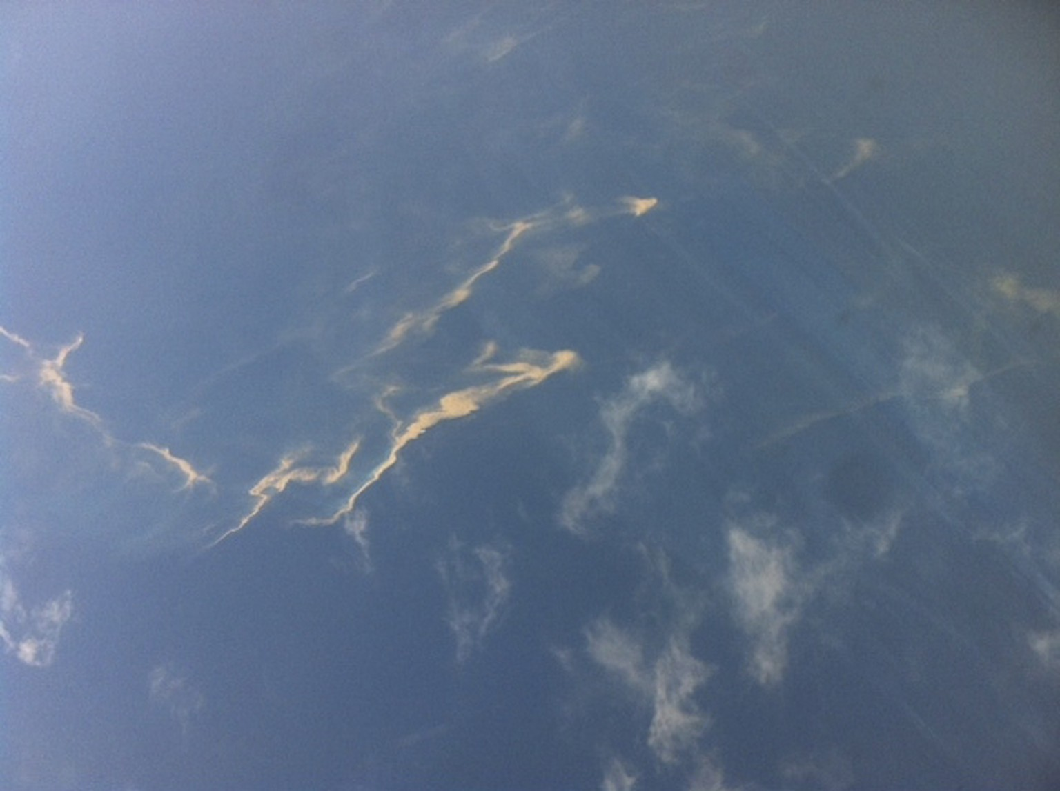 An aerial view of an oil spill is seen from a Vietnamese Air Force aircraft in the search area for a missing Malaysia Airlines plane, 250 km from Vietnam and 190 km from Malaysia, in this handout photo from Thanh Nien Newpaper taken on March 8, 2014. The Malaysia Airlines flight carrying 227 passengers and 12 crew went missing off the Vietnamese coast on Saturday as it flew from Kuala Lumpur to Beijing and was presumed to have crashed. There were no reports of bad weather and no sign why the Boeing 777-200ER, powered by Rolls-Royce Trent engines, would have vanished from radar screens about an hour after take-off. Mandatory Credit REUTERS/Trung Hieu/Thanh Nien Newspaper (VIETNAM - Tags: DISASTER TRANSPORT TPX IMAGES OF THE DAY) ATTENTION EDITORS - NO SALES. NO ARCHIVES. FOR EDITORIAL USE ONLY. NOT FOR SALE FOR MARKETING OR ADVERTISING CAMPAIGNS. THIS IMAGE HAS BEEN SUPPLIED BY A THIRD PARTY. IT IS DISTRIBUTED, EXACTLY AS RECEIVED BY REUTERS, AS A SERVICE TO CLIENTS. MANDATORY CREDIT. VIETNAM OUT. NO COMMERCIAL OR EDITORIAL SALES IN VIETNAM