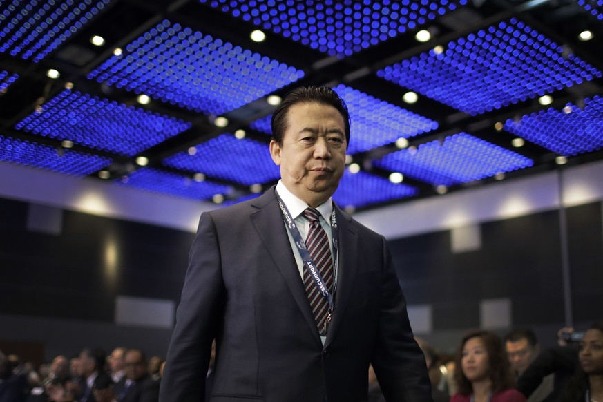 Interpol President, Meng Hongwei, walks towards the stage to deliver his opening address at the Interpol World congress on Tuesday, July 4, 2017, in Singapore. (AP Photo/Wong Maye-E)