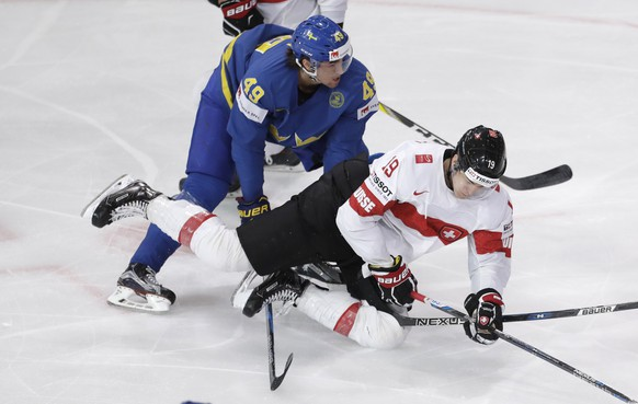 Sweden's Victor Rask, left, checks Switzerland's Reto Schappi, right, during the Ice Hockey World Championships quarterfinal match between Switzerland and Sweden in the AccorHotels Arena in Paris, France, Thursday, May 18, 2017. (AP Photo/Petr David Josek)