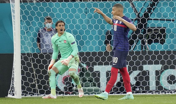 Switzerland's goalkeeper Yann Sommer reacts after France's Kylian Mbappe failed to score by penalty at the Euro 2020 soccer championship round of 16 match between France and Switzerland at the National Arena stadium in Bucharest, Romania, Tuesday, June 29, 2021. (AP Photo/Vadim Ghirda, Pool)