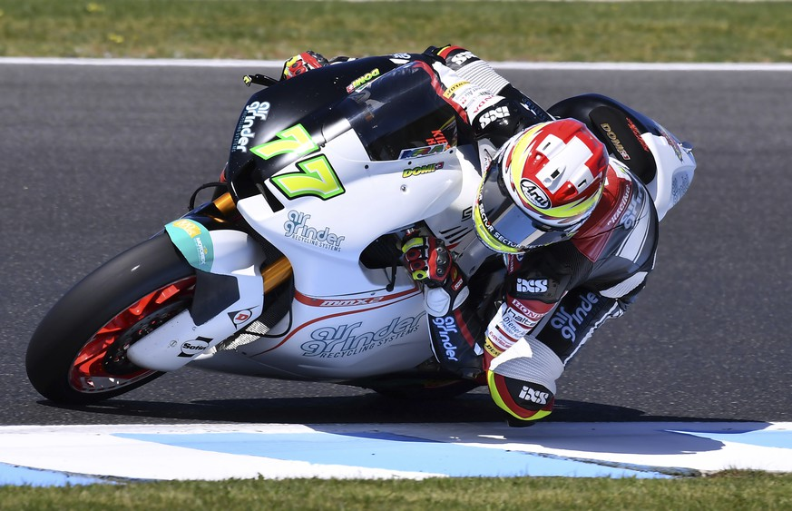 Switzerland's Moto2 rider Dominique Aegerter steers his Suter during the first practice session for the Australian Motorcycle Grand Prix at Phillip Island near Melbourne, Australia, Friday, Oct. 20, 2017. (AP Photo/Andy Brownbill)