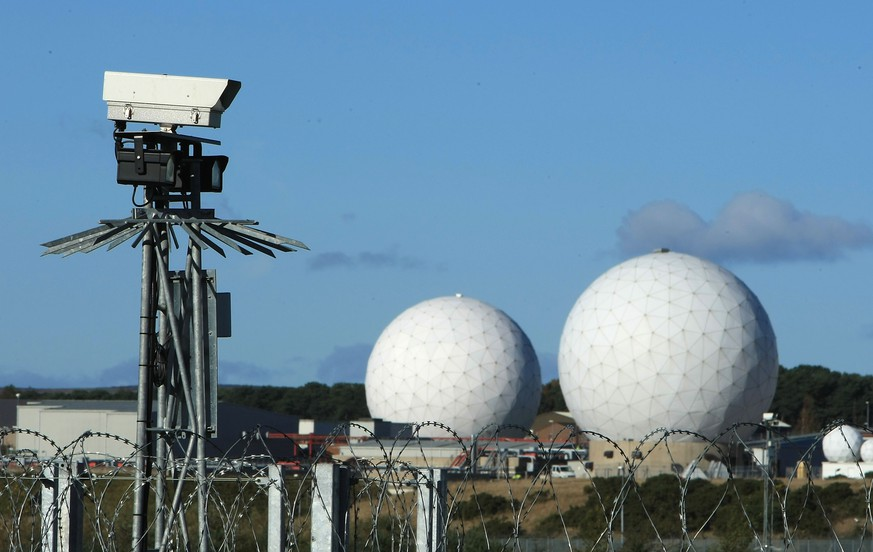 HARROGATE, UNITED KINGDOM - OCTOBER 30:  A security camera overlooks the radar domes of RAF Menwith Hill in north Yorkshire dominate the skyline on 30 October, 2007, Harrogate, England. The base is reported to be the biggest spy base in the world. Britain recently agreed to a United States request for the RAF Menwith Hill monitoring station, also known as the 13th field station of the US national security agency. in North Yorkshire to be used as part of its missile defence system, Dubbed 'Star War Bases' by anti-war and CND campaigners. The base houses British and United States personnel.  (Photo by Christopher Furlong/Getty Images)
