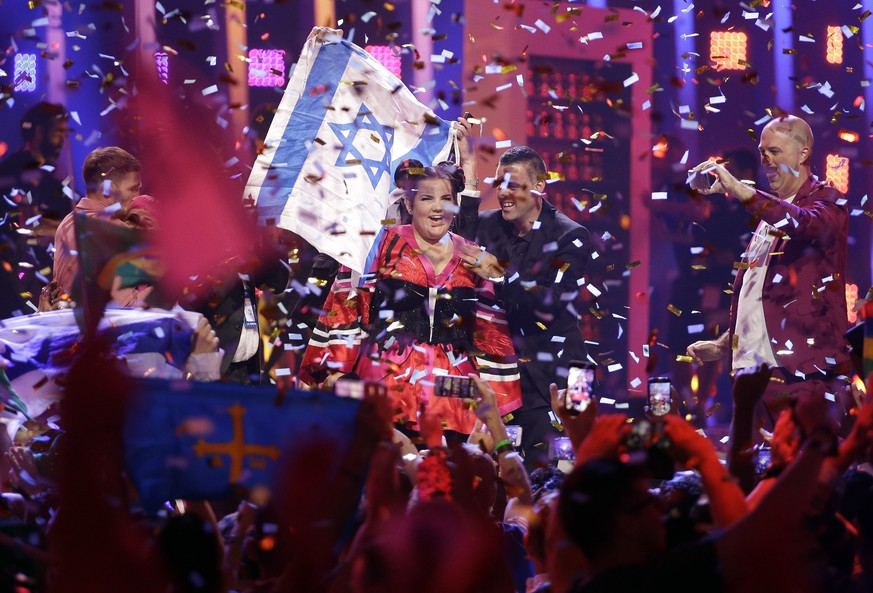 Netta from Israel celebrates after winning the Eurovision Song Contest grand final in Lisbon, Portugal, Saturday, May 12, 2018. (AP Photo/Armando Franca)