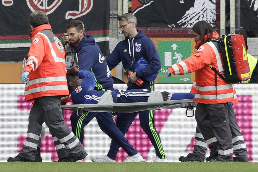 Schalke's Breel Embolo leaves the field on a stretcher during the German Bundesliga soccer match between FC Augsburg and FC Schalke 04 in Augsburg, Germany, Saturday, Oct. 15, 2016. (AP Photo/Matthias Schrader)