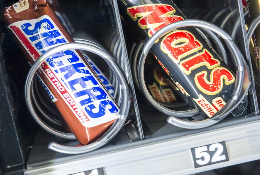 epa05178478 Mars, Snickers and other chocolate bars are for sale from a vending machine in De Meern, The Netherlands, 24 February 2016. US-based Mars food company issued a recall on 23 February of several chocolate bar brands in countries around the world after a piece of plastic was found in one of its products. The recall includes items packaged as Snickers, Mars, Milky Way and Celebration chocolates. A piece of plastic nearly one-half centimetre long was found in one product in Germany, the company said. The recall affects 56 countries, the European Commission said based on an EU alert issued by the Netherlands, where the chocolate bars were produced. The recall affects specific products made at the facility from 05 December 2015 to 18 January 2016, the statement said.  EPA/LEX VAN LIESHOUT