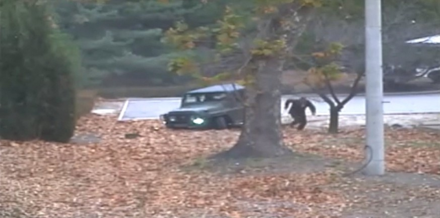 epa06343199 A handout screengrab of a surveillance video taken on 13 November 2017 and released by the United Nations Command (UNC) on 22 November 2017 shows a North Korean Korean People's Army (KPA) defector running out from a jeep at the Joint Security Area (JSA) of the Korean Demilitarized Zone (DMZ). According to the UNC, a UNC Special Investigation Team conducted an investigation into the footage saying that the KPA violated the UN Armistice Agreement twice during the event by 'firing weapons across the Military Demarcation Line (MDL) and when the defecting soldier actually temporarily crossed the MDL' to reach the Joint Security Area (JSA) in the village of Panmunjom on 13 November 2017.  EPA/UNITED NATIONS COMMAND HANDOUT -- BEST QUALITY AVAILABLE -- HANDOUT EDITORIAL USE ONLY/NO SALES