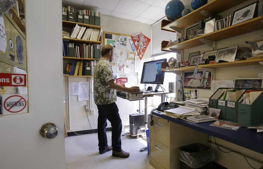 In this June 30, 2014 photo, Ken Buesseler, senior scientist of marine chemistry and geochemistry works in his office at his Woods Hole Oceanographic Institution research facility in Woods Hole, Mass. Buesseler with the help of crowdfunding, the practice of using the Internet to raise relatively small amounts of money from a lot of people to finance a project, is investigating the amount of Cesium 134 that can be found in the waters off the U.S. in the wake of the Fukushima Daiichi nuclear disaster. (AP Photo Stephan Savoia)