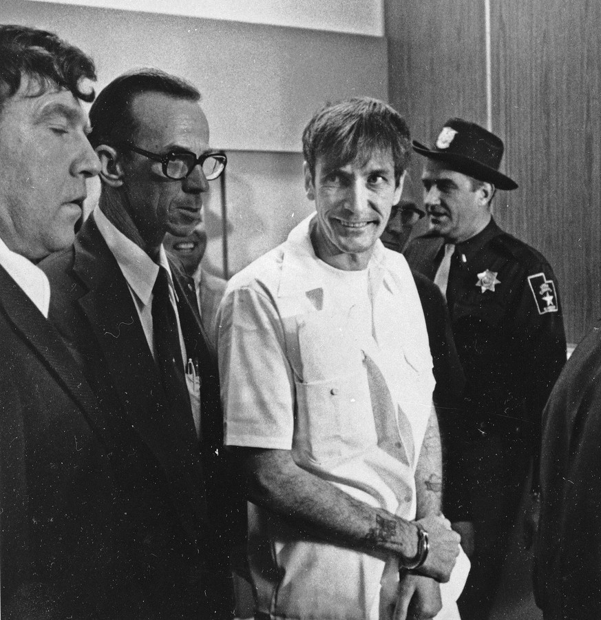 FILE - In this Dev. 1, 1976 file photo, convicted murderer Gary Mark Gilmore arrives heavily guarded to 4th District Court in Provo, Utah. Gilmore was executed by firing squad Jan. 17, 1977. The Republican-controlled Utah Legislature on Tuesday, March 10, 2015 gave final approval to a proposal to bring back firing squad executions if the state cannot track down drugs used in lethal injections. (AP Photo/Ron Barker, File)