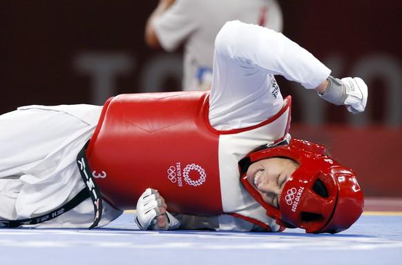 epa09363722 Refugee Olympic Team's Kimia Alizadeh Zenoorin reacts during her match against China's Zhou Lijun in the Taekwondo Women -57kg quarterfinal of the Tokyo 2020 Olympics at the Makuhari Messe convention centre in Chiba, Japan, 25 July 2021.  EPA/RUNGROJ YONGRIT