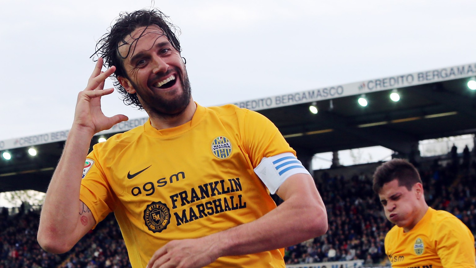 Hellas Verona's Luca Toni celebrates after scoring during a Serie A soccer match against Atalanta in Bergamo, Italy, Saturday, April 19, 2014. (AP Photo/Felice Calabro')