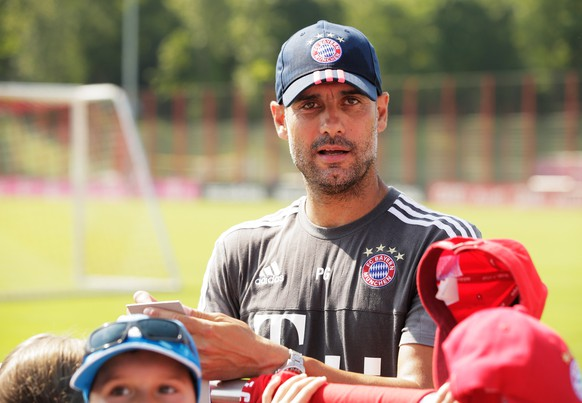 MUNICH, GERMANY - JULY 07:  Joespe Guardiola of Bayern Muenchen signs autographs after the FC Bayern Muenchen Training Session at the Bayern Munich training grounds on July 7, 2015 in Munich, Germany.  (Photo by Adam Pretty/Bongarts/Getty Images)