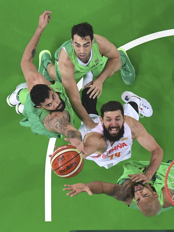 2016 Rio Olympics - Basketball - Preliminary - Men's Preliminary Round Group B Spain v Brazil - Carioca Arena 1 - Rio de Janeiro, Brazil - 09/08/2016. Nikola Mirotic (ESP) of Spain tries to shoot as he is covered by Marquinhos (BRA) (Basketball) of Brazil, Augusto Lima (BRA) of Brazil and Vitor Benite (BRA) of Brazil. REUTERS/Andrej Isakovic/Pool FOR EDITORIAL USE ONLY. NOT FOR SALE FOR MARKETING OR ADVERTISING CAMPAIGNS.