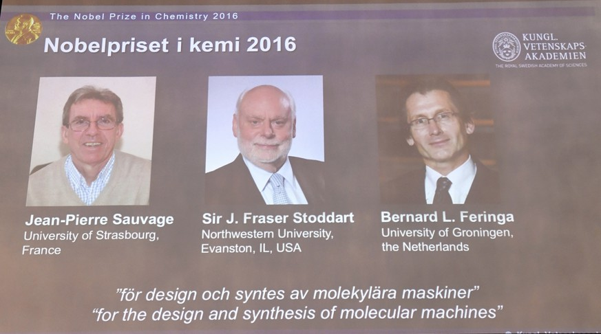 The Royal Academy of Sciences members  reveal the winners of the Nobel Prize in Chemistry, at the Royal Swedish Academy of Sciences, in Stockholm, Sweden, Wednesday, Oct. 5, 2016. Jean-Pierre Sauvage, Fraser Stoddart and Bernard Feringa have been awarded the Nobel chemistry prize. (Henrik Montgomery /TT via AP)