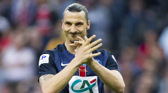 Paris Saint Germain's Zlatan Ibrahimovic reacts after his team missed to score a goal during the French Cup final soccer match against Auxerre at the Stade de France Stadium, in Saint Denis, north of Paris, Saturday May 30, 2015. (AP Photo/Jacques Brinon)
