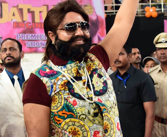 epa06162256 (FILE) - India's self-styled guru and spiritual leader turned actor, Gurmeet Ram Rahim Singh waves during a 'Cow Milk Party', held at the premiere of his movie 'Jattu Engineer' in New Delhi, India, 17 May 2017 (reissued 25 August 2017). An Indian court on 25 August 2017 found Ram Rahim Singh guilty of rape, sentencing him to 7 years in jail.  EPA/STR