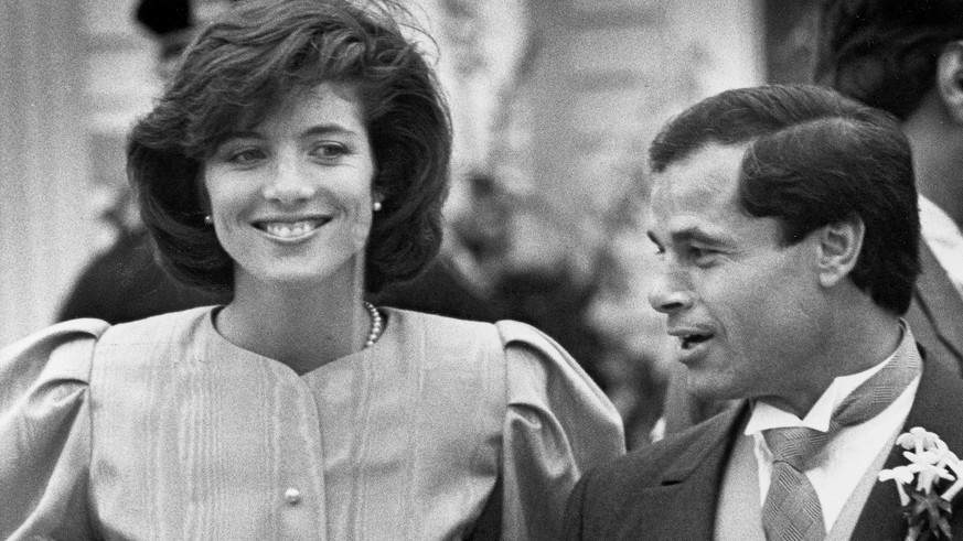 FILE - In this April 26, 1986 file photo, maid of Honor Caroline Kennedy and Best Man Franco Columbu, leave St. Francis Xavier Church after the wedding of Caroline's cousin Maria Shriver to Arnold Schwarzenegger in Hyannis, Mass.. Italian bodybuilder, boxer and actor Franco Columbu, one of Arnold Schwarzenegger's closest friends, has died aged 78. Columbu died in a hospital in his native Sardinia on Friday, Aug. 30, 2019 afternoon after being taken ill while he was swimming in the sea. (AP Photo/Mike Kullen, file) KENNEDY COLUMBU