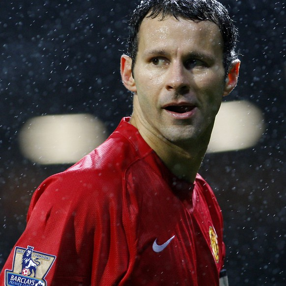 FILE - This is a Saturday Dec. 8, 2007 file photo of Manchester United's Ryan Giggs as he  prepares to take a corner in the rain against Derby County during their English Premier League soccer match at Old Trafford Stadium, Manchester, England. Ryan Giggs Friday July 1, 2016  ended his 29-year association with Manchester United, leaving the coaching staff at the fallen Premier League powers at the start of Jose Mourinho's reign.  The 42-year-old Giggs joined United in 1987 as a 14-year-old went on to play a record 963 times for the first team, mostly under Alex Ferguson. (AP Photo/Jon Super, File)
