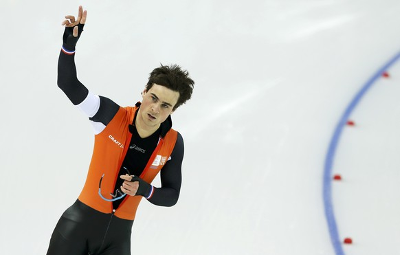 Jan Smeekens of the Netherlands reacts after the men's 500 metres speed skating race at the Adler Arena during the 2014 Sochi Winter Olympics February 10, 2014. REUTERS/Phil Noble (RUSSIA  - Tags: OLYMPICS SPORT SPEED SKATING)