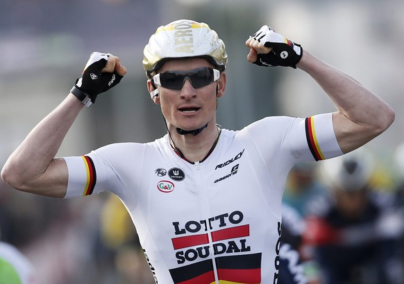 epa04656369 German rider Andre Greipel of the Lotto Soudal team celebrates crossing the finish line to win the second stage of the Paris-Nice cycling race between Saint Aignan and Saint Amand Montrond, France, 10 March 2015.  EPA/SEBASTIEN NOGIER