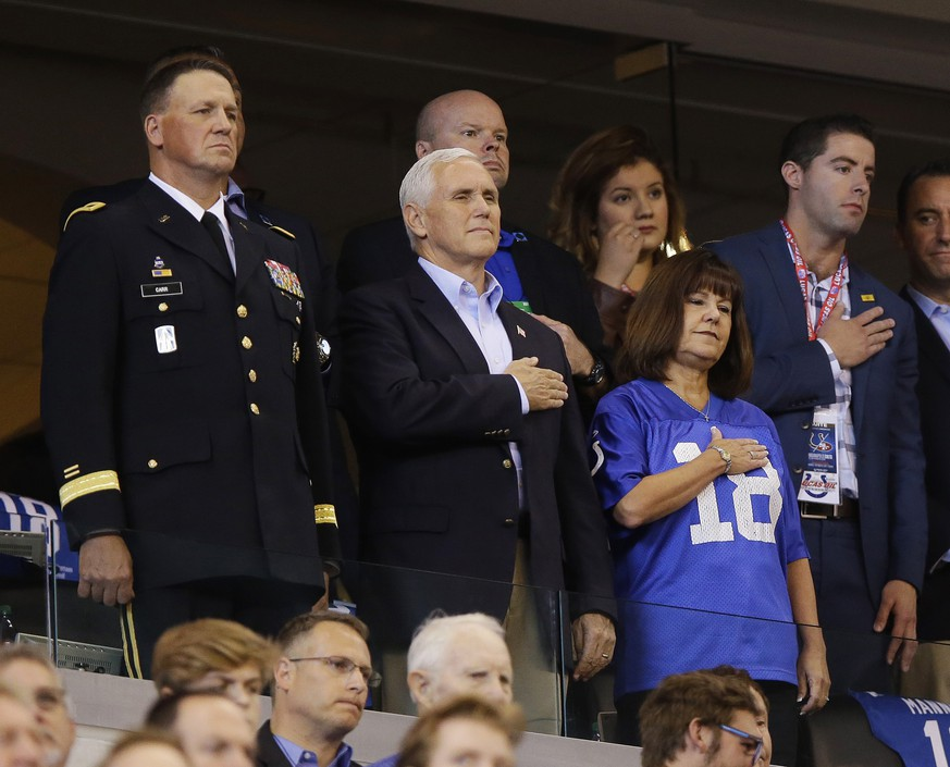 Vice President Mike Pence, front center, stands during the playing of the national anthem before an NFL football game between the Indianapolis Colts and the San Francisco 49ers, Sunday, Oct. 8, 2017, in Indianapolis. (AP Photo/Michael Conroy)