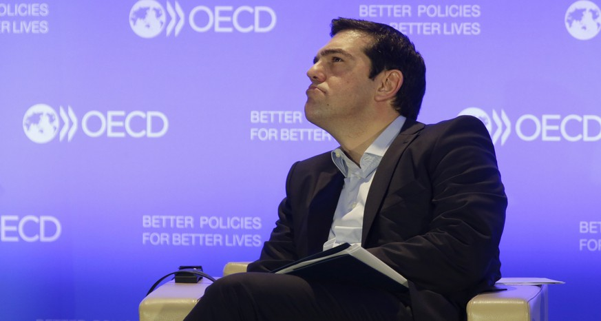 Greek Prime Minister Alexis Tsipras attends a news conference at the Organisation for Economic Cooperation and Development (OECD) headquarters in Paris March 12, 2015. Greece is in a position to meet its financial obligations even if does not receive a further instalment of its frozen international bailout, Greek Prime Minister Alexis Tsipras said on Thursday during a visit to France.  REUTERS/Philippe Wojazer  (FRANCE - Tags: POLITICS)