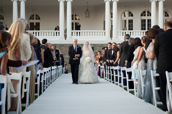 This photo released by Genevieve de Manio Photography shows former President Bill Clinton walking his daughter Chelsea down the isle for her wedding Saturday July 31, 2010 in Rhinebeck,N.Y. (AP Photo/Genevieve de Manio Photography,Genevieve de Manio)**NO SALES**