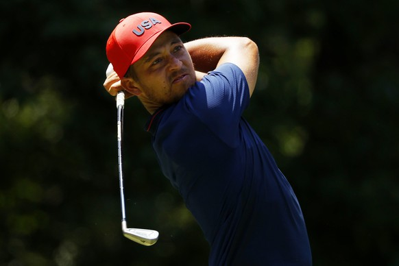 epa09383987 Xander Schauffele of USA tees off on the fourth tee during the Men's Individual Stroke Play Round 4 at the Golf events of the Tokyo 2020 Olympic Games at the Kasumigaseki Country Club in Kawagoe, Japan, 01 August 2021.  EPA/MICHAEL REYNOLDS