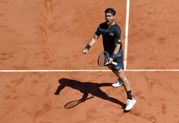 epa07617232 Fabio Fognini of Italy reacts as he plays Roberto Bautista Agut of Spain during their men's third round match during the French Open tennis tournament at Roland Garros in Paris, France, 01 June 2019.  EPA/JULIEN DE ROSA