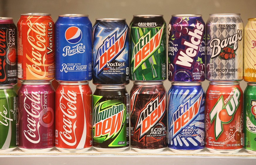 BERLIN, GERMANY - JANUARY 16:  Sugary softdrinks from the USA, including Mountain Dew, Coca-Cola, 7Up and Pepsi, stand on display at a stand at the International Green Week agricultural trade fair (Internationale Gruene Woche) on January 16, 2015 in Berlin, Germany. The International Green Week is the world's largest agricultural trade fair and is open to the public from January 16-25.  (Photo by Sean Gallup/Getty Images)