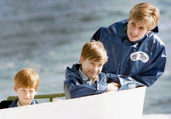 Diana, Princess of Wales, enjoys a ride on the Maid of Mist in Niagara Falls, Ont., in this October 1991, photo, with her sons Prince Harry, then 7, and Prince William, then 9.  (KEYSTONE/AP Photo/Hans Deryk)
