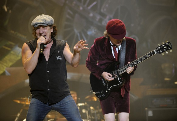 FILE -  In this Nov. 12, 2008 file photo, AC/DC lead singer Brian Johnson, left, and Angus Young perform on the Black Ice tour at Madison Square Garden in New York. Columbia Records and Apple announced Monday, Nov. 19, 2012, that the classic rock band's music will be available at the iTunes Store worldwide. Sixteen albums will be released, including