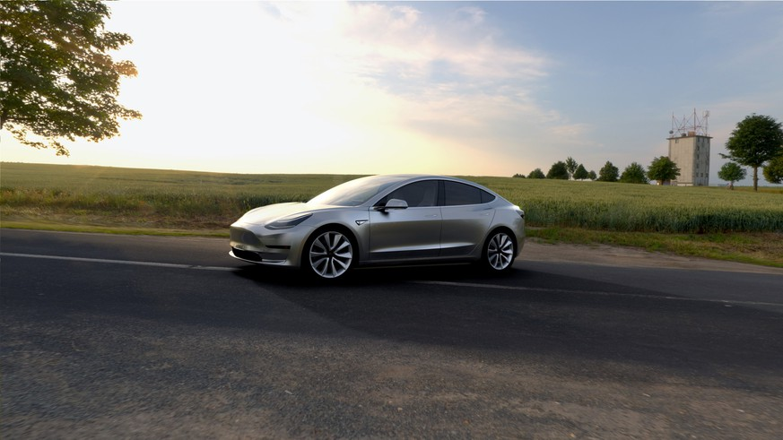 epa06063957 A undated handout photo made available by Tesla Motors on 03 July 2017 shows Tesla Model 3 in silver. The all-electric Model 3 was unveiled on 31 March 2016.  According to a tweet by Elon Musk, CEO of Tesla Inc., Model 3 passed all regulatory requirements for production and is expected to be rolling off production line this week.  EPA/HANDOUT HANDOUT  HANDOUT EDITORIAL USE ONLY/NO SALES