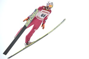 Kamil Stoch of Poland soars through the air during Ski Jumping Large Hill Individual competition in the FIS World Cup, in Lahti, Finland, Sunday, March 2, 2014. (AP Photo /Lehtikuva, Heikki Saukkomaa)  FINLAND OUT