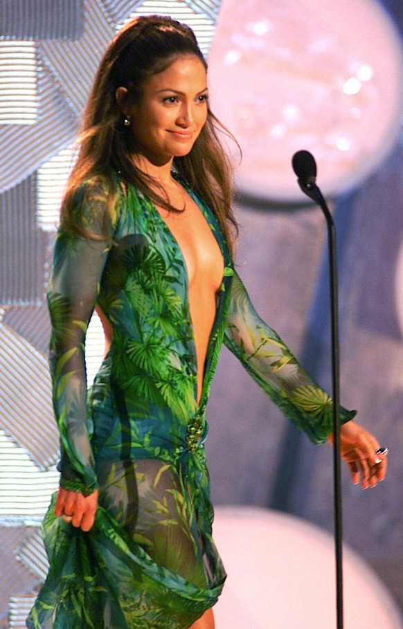 FILE - In this Feb. 23, 2000 file photo, Jennifer Lopez, wearing a sheer, low-cut silk chiffon Versace dress, appears on-stage to present an award during the 42nd Grammy Awards in Los Angeles. (AP Photo/Kevork Djansezian, File)