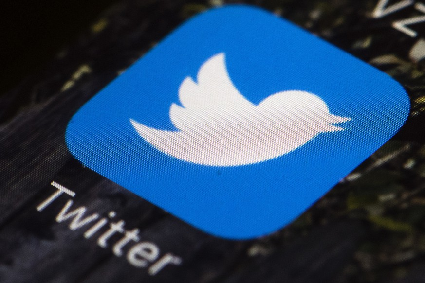 FILE - This April 26, 2017, file photo shows the Twitter app icon on a mobile phone in Philadelphia. Twitter said Thursday, July 11, 2019, that it is investigating a problem with its service. Users across the U.S. and elsewhere are not able to access Twitter. (AP Photo/Matt Rourke, File)