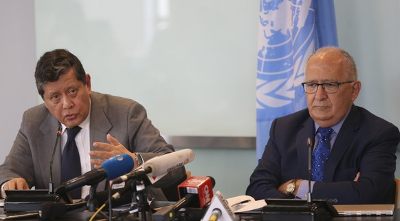 Marzuki Darusman, left, chair of the UN fact-finding mission on Myanmar gestures and Christopher Sidoti, right, an international human rights lawyer, listen during a press conference in Jakarta, Indonesia, Monday, Aug. 5, 2019. A United Nations fact-finding mission called Monday for an embargo on arms sales to Myanmar and targeted sanctions against businesses with connections to the military after finding they are helping fund human rights abuses.(AP Photo/Achmad Ibrahim) Marzuki Darusman,Christopher Sidoti