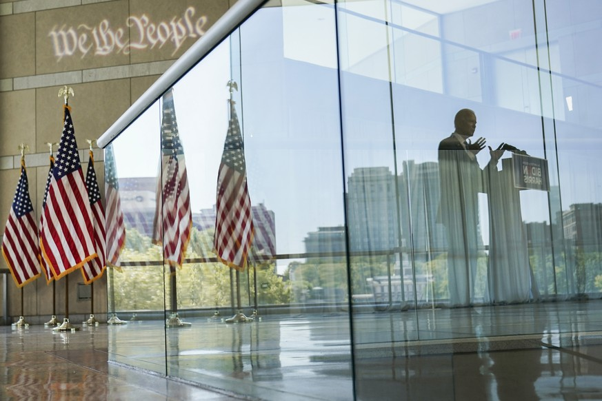Democratic presidential candidate and former Vice President Joe Biden's reflection is seen from a glass railing while he speaks at the Constitution Center in Philadelphia, Sunday, Sept. 20, 2020, about the Supreme Court. (AP Photo/Carolyn Kaster) Joe Biden