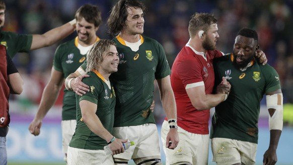 South Africa's Faf de Klerk, left, and South Africa's Franco Mostert after winning the Rugby World Cup semifinal at International Yokohama Stadium between Wales and South Africa in Yokohama, Japan, Sunday, Oct. 27, 2019. (AP Photo/Mark Baker)