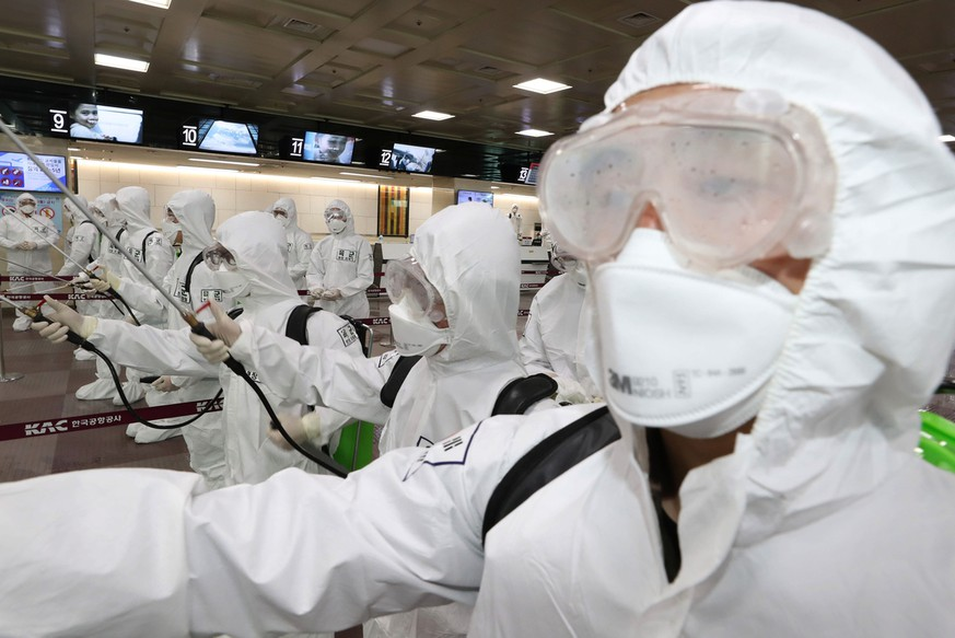 South Korean army soldiers wearing protective suits spray disinfectant to prevent the spread of the new coronavirus at Daegu International Airport in Daegu, South Korea, Friday, March 6, 2020. Seoul expressed âÄœextreme regretâĝ Friday over JapanâÄ™s ordering 14-day quarantines on all visitors from South Korea due to a surge in viral infections and warned of retaliation if Tokyo doesnâÄ™t withdraw the restrictions. (Kim Joo-sung/Yonhap via AP)
