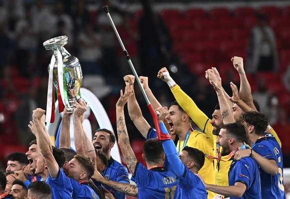 Italy's players celebrate with trophy after winning the Euro 2020 soccer championship final match between England and Italy at Wembley Stadium in London, Sunday, July 11, 2021. (Paul Ellis/Pool via AP)