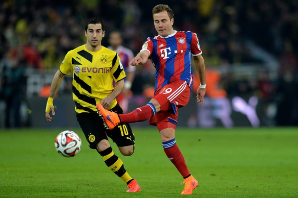 DORTMUND, GERMANY - APRIL 04:  (L-R) Henrikh Mkhitaryan of Dortmund vies with Mario Goetze of Muenchen during the Bundesliga match between Borussia Dortmund and FC Bayern Muenchen at Signal Iduna Park on April 4, 2015 in Dortmund, Germany.  (Photo by Sascha Steinbach/Getty Images For MAN)