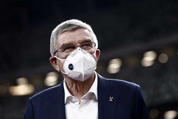 FILE - In this Nov. 17, 2020, file photo, IOC President Thomas Bach visits the National Stadium, the main venue for the 2020 Olympic and Paralympic Games postponed until July 2021 due to the coronavirus pandemic, in Tokyo. Bach has canceled a trip in May 2021 to Japan because of surging cases of COVID-19 in the country, the Tokyo Olympic organizing committee said Monday, May 10, 2021 in a statement. The trip was made impossible because of a state of emergency in Tokyo and other parts of the country that has been extended until May 31. (Behrouz Mehri/Pool Photo via AP, Fo;e) Thomas Bach