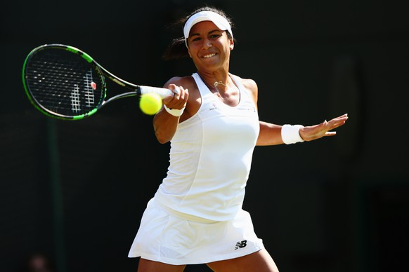 LONDON, ENGLAND - JULY 01:  Heather Watson of Great Britain plays a forehand during her Ladies Singles Second Round match against Daniela Hantuchova of Slovakia during day three of the Wimbledon Lawn Tennis Championships at the All England Lawn Tennis and Croquet Club on July 1, 2015 in London, England.  (Photo by Ian Walton/Getty Images)