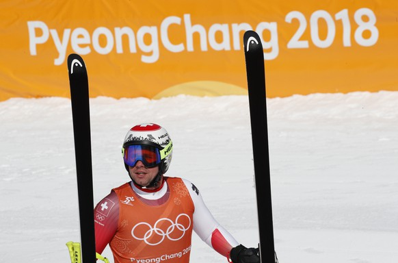 Switzerland's BeatFeuz pauses after finishing men's downhill training at the 2018 Winter Olympics in Jeongseon, South Korea, Friday, Feb. 9, 2018. (AP Photo/Christophe Ena)