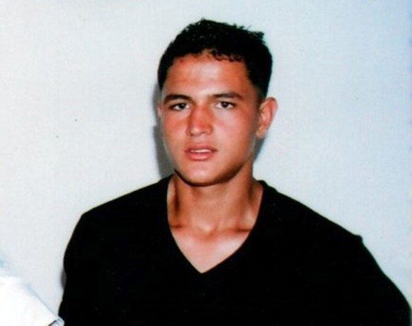"This undated picture provided by Najoua Amri on Thursday, Dec. 22, 2016, shows the fugitive Tunisian suspected in Berlin's deadly Christmas market attack, Anis Amri, posing at his parents' house in Oueslatia, central Tunisia. German authorities issued a wanted notice for Anis Amri on Wednesday and offered a reward of up to 100,000 euros ($104,000) for information leading to the 24-year-old's arrest, warning that he could be ""violent and armed."" (Courtesy Najoua Amri to AP)"