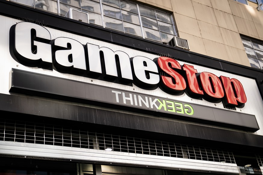 FILE - Pedestrians pass a GameStop store on 14th Street at Union Square, Thursday, Jan. 28, 2021, in the Manhattan borough of New York.   Followers of YouTube personality Roaring Kitty, inspired by his enthusiasm for buying stock in the underdog retailer GameStop, made him an icon in the social media frenzy that shocked Wall Street. But what