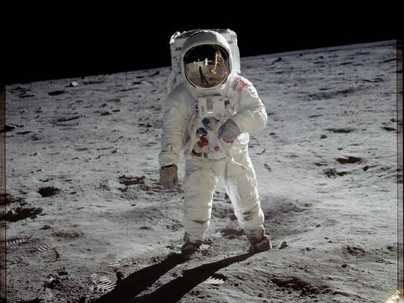 Astronaut Buzz Aldrin walks on the surface of the moon near the leg of the lunar module Eagle during the Apollo 11 mission. Mission commander Neil Armstrong took this photograph with a 70mm lunar surface camera. While astronauts Armstrong and Aldrin explored the Sea of Tranquility region of the moon, astronaut Michael Collins remained with the command and service modules in lunar orbit.Image Credit: NASA
