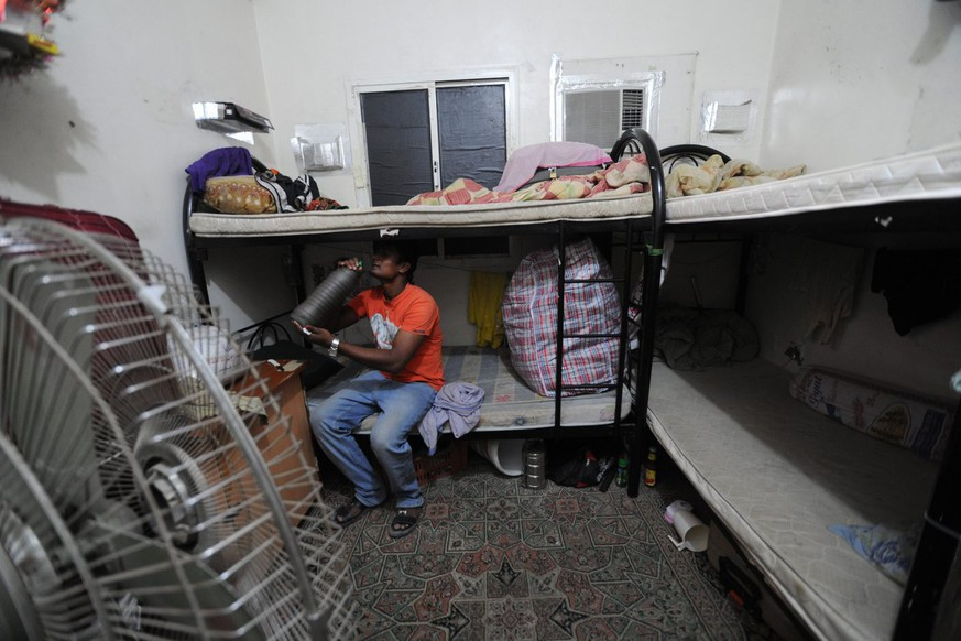 "epa03955192 An Amnesty International handout photo dated 2012 shows a migrant worker sitting on a bunk bed in his accommodation in Qatar. Amnesty International on 17 November 2013 released a report blasting the conditions of migrant construction workers in Qatar, as the country prepares its infrastructure for the 2022 FIFA football World Cup. Workers in the oil- and gas-rich Gulf state suffer difficulties including ""non-payment of wages, harsh and dangerous working conditions, and shocking standards of accommodation,"" the Britain-based rights group said.  EPA/AMNESTY INTERNATIONAL/HANDOUT MANDATORY CREDIT: AMNESTY INTERNATIONAL HANDOUT EDITORIAL USE ONLY/NO SALES"