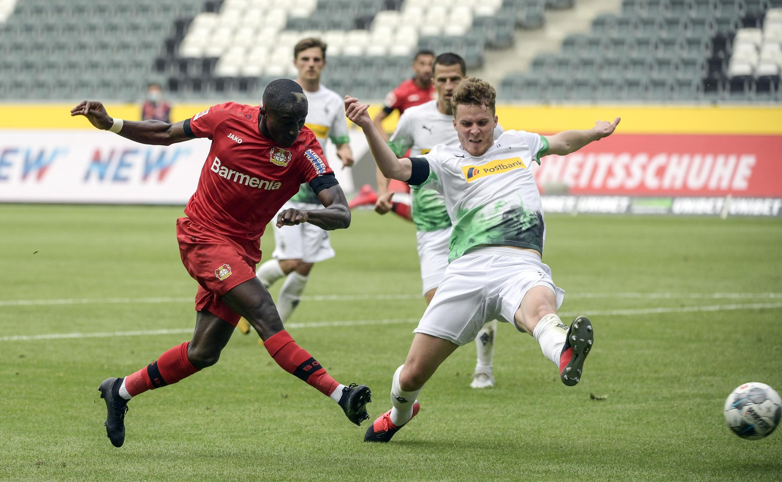 Leverkusen's French forward Moussa Diaby, left, and Moenchengladbach's Swiss defender Nico Elvedi vie for the ball during the German Bundesliga soccer match between Borussia Moenchengladbach and Leverkusen, in Moenchengladbach, Germany, Saturday, May 23, 2020. (Ina Fassbender Pool Photo via AP)